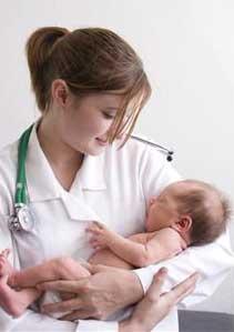 nurse holding a baby